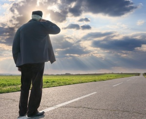 Elderly man looking into the distance along the road